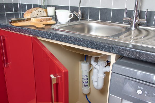 Glacier GW3 undersink inline water filter installed in kitchen to remove chlroine, heavy metals and chemicals from cold water.