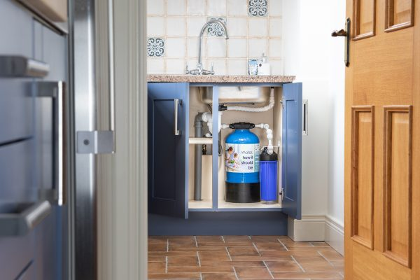 Glacier GW5 8x19 inline undersink whole house water filter installed in kitchen to filter all the water in the home.